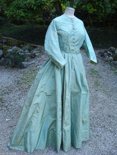 1860's high waisted silk day dress, metal rings and drawstring inside the skirt to lift the hem while walking