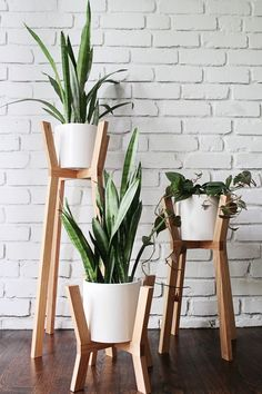 loving these wood and white modern plant stands /