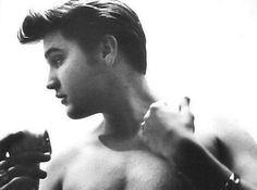 Elvis Presley looking striking like Michelangelo's statue of David