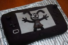 My attempt at a WiiU Epic Mickey Oswald the Rabbit cake.