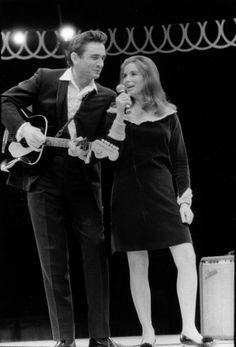 Johnny Cash and June Carter  I watched them in awe when I was a girl... Even then, I felt there was something special about those two...