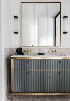 We absolutely love the brass framed unit in this bathroom.