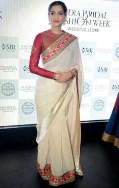 Sonam in beautiful beige with red sari :) Saree Blouse Neck Designs, Saree Blouse Patterns, Stylish Sarees, Trendy Sarees, Lehenga, Anarkali, Lehanga Saree, Indian Dresses, Indian Outfits