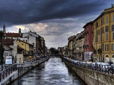 The districts of Navigli and Porta Ticinese have been important places for trade and commerce since the Middle Ages because of the canals and waterways that run through them. Today, this area is the heart of Milan's nightlife, with streets full of lively bars and restaurants. It's a great place for a relaxing waterside stroll and people watching.