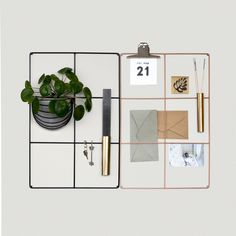 Wallment 6 Square Grid wire mesh memo board for a minimal nordic workspace in Black and Nude. Can be combined with Wallment Baskette wall basket for a green wall to make for an inspiring office space.