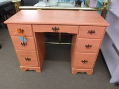 $139 - Shabby 7 drawer desk - painted coral and finished in a tinted wax - original hardware. ***** In Booth D16 at Main Street Antique Mall 7260 E Main St (east of Power RD on MAIN STREET) Mesa Az 85207 **** Open 7 days a week 10:00AM-5:30PM **** Call for more information 480 924 1122 **** We Accept cash, debit, VISA, Mastercard, Discover or American Express