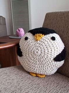 Crochet an animal pillow...many more animal designs here too besides a penguin.