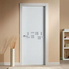 The beautiful prefinished San Rafael Lacada 908C FD30 Fire Door with inlay designs, pre-finished. #puertassanrafael #lacadadoors