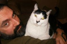 Peter Steele and his cat (who has the same expression on its face that he always had).  He even wrote a love song to his cat when it died (everything thinks it's about a girl...bwahah)