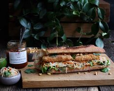 Crispy & Spicy Tofu Bánh Mì with Green Papaya Slaw. Very easy to make and vegetarian.  The tofu is coated in a sambal marinade, and then coated in panko to seal in all the flavours. Served as a sandwich with a nice baguette and green papaya slaw. Made with Taotjo Sambal.