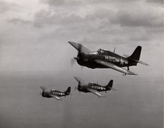 Three FM-2 Wildcats flying over Lake Michigan, United States during carrier qualifications aboard the training aircraft carrier USS Sable, 1943-44.