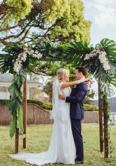 Tropical luxe ceremony arbour by Lola Mai Floral Styling.