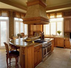 kitchen island .. like the curve of it and the granite countertop. Like the color of the cabinets.
