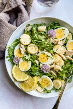 This heart of palm salad with arugula, chicken, and hard-boiled eggs is an easy, flavorful main course for two people. It can easily be scaled up. It's a refreshing and healthy main course salad recipe that you'll love.