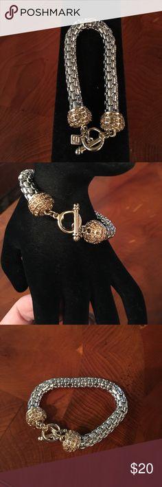 Banana republic bracelet Ladies banana republic silver/gold mesh like  bracelet with toggle closure.  Balls have gold pave gold stones. Jewelry Bracelets