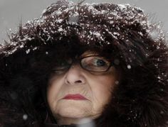 Woman, not amused, by today's snow storm in Buffalo, NY.