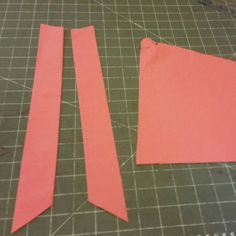 V-neck and pockets cut out. And coral they are.