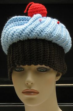 Crocheted Chocolate Cupcake Hat with Blue Frosting and Multi-Colored Sprinkles by Xasper8ing, $30.00
