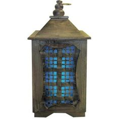 "15"" Solar Temple Lantern with Blue Light. This Solar Temple Lantern is made from durable wood and is art sculpture by day - and lantern by night -hang it or place on a table. Unique internal solar module for a clean, neat, sophisticated look. Built in photo sensor turns unit on at dusk and illuminates for hours on full charge. LED light provides a soothing light diffusing glow. Rechargeable battery included. #temple #lantern #solar"