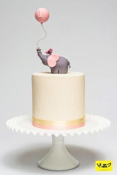 Colors of cake, but pink bottom, I want to make it pearls in icing all the way around. Banner on each side... wider and not so tall cake. Getting stuffed elephant keepsake to have in middle of cake.