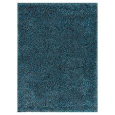 Anchor your living room seating group or define a space in your master suite with this artfully crafted shag rug, showcasing a peacock hue for eye-catching a...