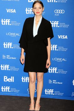 Blood Ties press conference, Toronto Film Festival – September 10 2013  Marion Cotillard wore a Christian Dior Couture dress and heels.
