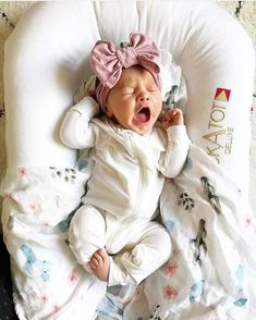 Adorable girl with an oversized head bow! Yawning in the cutest way!