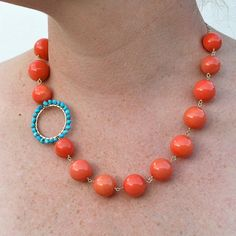 two favorite colors for spring...bright coral beads with a cool turquoise hoop