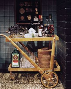 Bar Photo - A bar cart of entertaining essentials and plaid walls paired with leopard-print carpet Rattan, Vintage Bar Carts, Drink Cart, Bar Drinks, Drinks Trolley, Small Bars, Bar Set, Do It Yourself Home, Cool Bars