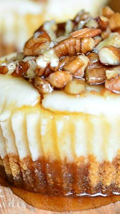 Maple Pecan Mini Cheesecakes ~ Soft, smooth mini cheesecakes made with maple flavor, pecan/maple crust and topped of with pure maple syrup and crushed pecans.