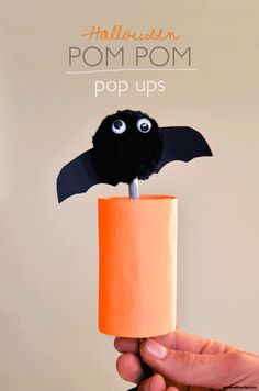 Halloween Craft / Halloween Pompom Pop Ups! Full tutorial at willowday -- they're note scary to make at all!