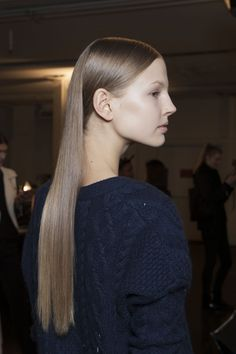 Super shiny smooth hair, sides tucked back.