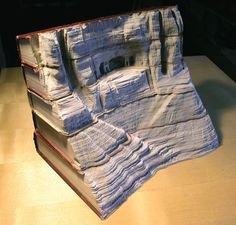 Incredible Landscapes Carved Into Books - a collection of Guy Laramee's incredible book carving work from his series' titled The Great Wall and Biblios. In these series, Guy carves magnificent landscapes into relevant volumes of work, some pieces using well over ten books.