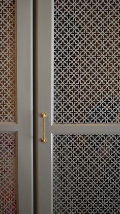 Gray quatrefoil mudroom cabinets