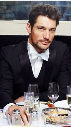 David Gandy in Dolce Gabbana tux. want my husband to wear white bow tie (his identical twin wears black tie). I obviously can tell who is my husband but confusing for guests & photographer when identical twins. -Mari