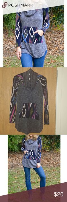 Tribal Print Knit Sweater. NWOT. Long sleeve cowl neck tribal print sweater with kangaroo pocket. NWOT. 74% polyester 26% rayon. Tops