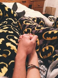 Geek Relationship Goals So Cute, You'll Cringe: Matching superhero pajamas.