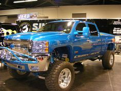 blue lifted Chevrolet Silverado