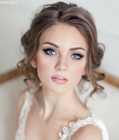 Gorgeous hair and make up.