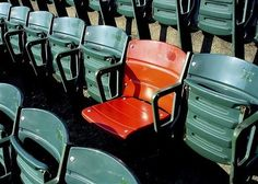 The red seat in Fenway, marks the spot where the longest home run in Fenway Park history was hit by Ted Williams :)