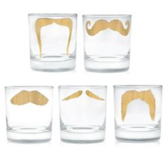 24k Gold Moustache Tumbler Set. Start or end your day with a smile—one that's topped with a fake novelty moustache courtesy of these mugs and tumblers. Add a little extra oomph to cocktails, water or anything else you're imbibing with this set of five moustache glasses. $145.00