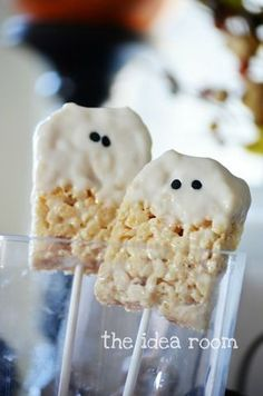 Rice Krispie Treats on a stick dipped in white chocolate and use mini chocolate chips for the eyes