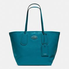 Another great deal from Coach...just $163 (originally $325) It comes in Black, Coral & Chalk too. The Coach Taxi Tote 28 In Leather from Coach