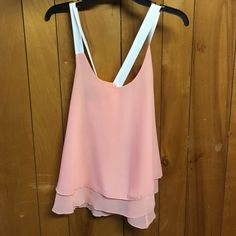 Peach and cream tank top. Straps cross in the back Peach and cream tank top. Straps cross in the back Tops Tank Tops