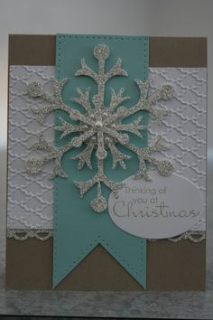 Glimmer Snowflake---Stampin Up silver glimmer paper and fancy folds embossing folder