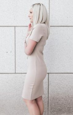 Classic shaping with modern details make this lace up dress a guaranteed knockout. Comfortable, substantial knit with just the right amount of stretch creates a very flattering silhouette while the ne