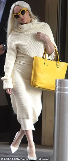 Loevly lady: The 27-year-old musician sported a thick cream coloured sweater dress with a long skirt and a turtleneck top as she headed for ...