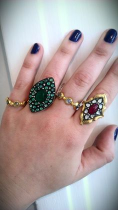 Emerald, ruby, diamond, silver and gold rings by Atelier Minyon.