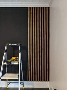 Ever since the first time I saw a slat wall, I couldn't wait to add one to my home! I have seen many different styles (plain wood against a white wall, painted wood on a painted wall…) … Wood Slat Wall, Wood Slats, Wood On Walls, Wood Paneling Walls, Painted Garage Walls, Interior Wood Paneling, Diy Wood Wall, Wall Panelling, Modern Wall Paneling