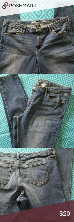 Mossimo Skinny Jeans Mossimo Mid rise skinny jeans size 18R  34 inseam. Perfect condition. Very comfortable. With intentional fading. Mossimo Supply Co Jeans